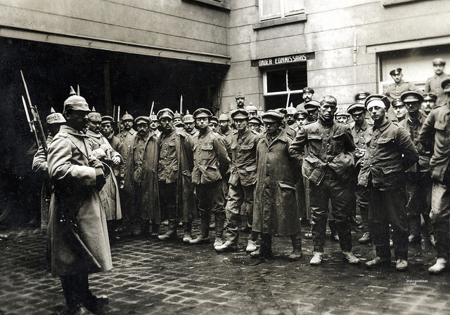 Wet and muddied, English prisoners of war are assembled in a Belgian courtyard shortly after their arrival from the battlefields near Ypres, sometime around April 1915. The Second Battle of Ypres was fought in the Spring of 1915 and it was during this battle, the Germans used poisonous gas for the first time on the Western Front. Prior to this they had been gassing Russians on the Eastern Front with some success.