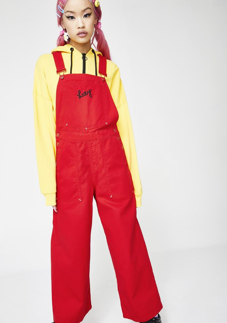 """Lazy Oaf Red Faced Dungarees will make ya stand out. These bold red overalls have adjustable straps, a loose N' comfy fit, black """"Lazy"""" text on the front, and lil eyes on the back.   #dollskill #lazyoaf #newarrivals #dresses #coco #babydoll"""