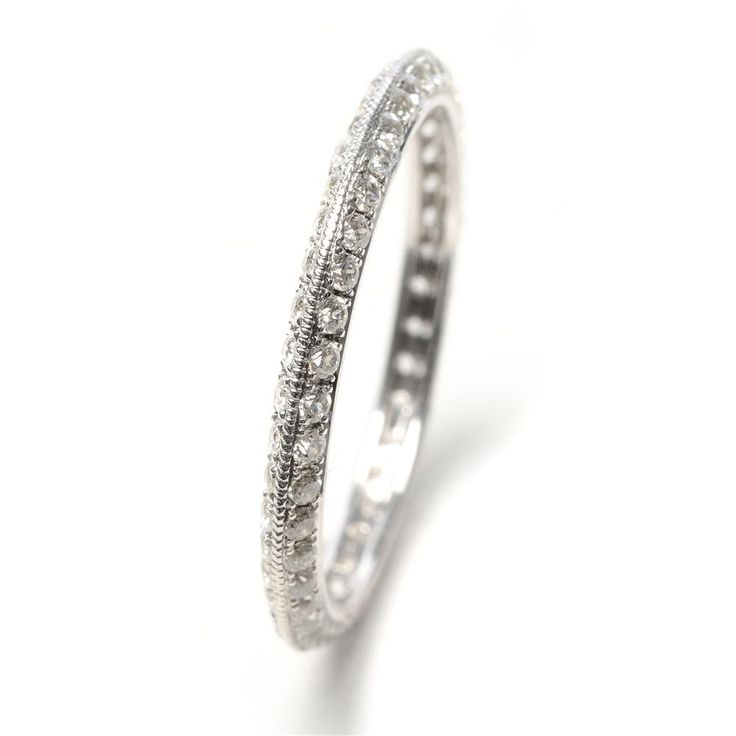 This sparkling wedding band features a knife edge design, and is covered with micropave diamonds and milgrain details.