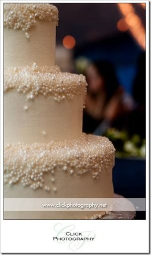 A wedding cake with pearls.  Reminds me of champagne bubbles :)