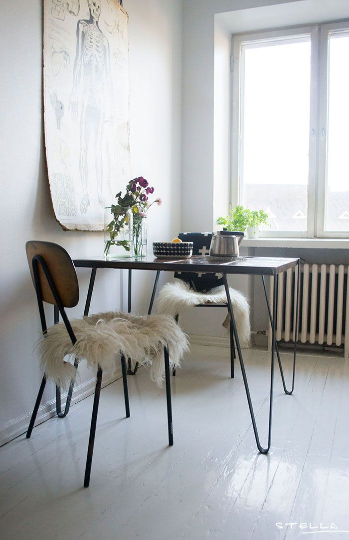 Simple kitchen eating nook with hairpin leg table and fur throws--image via Decor8