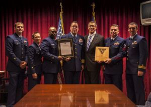Crewmembers from Coast Guard Cutter Boutwell, homeported in San Diego, stand for a photo with U.S. Interdiction Coordinator James C. Olson following an award ceremony at the White House Office National Drug Control Policy in Washington, D.C., Oct. 27, 2015. The crew of Boutwell was awarded for a seizure of cocaine during a deployment near Guatemala Sept. 11, 2014. (U.S. Coast Guard photo by Petty Officer 2nd Class Diana Honings)