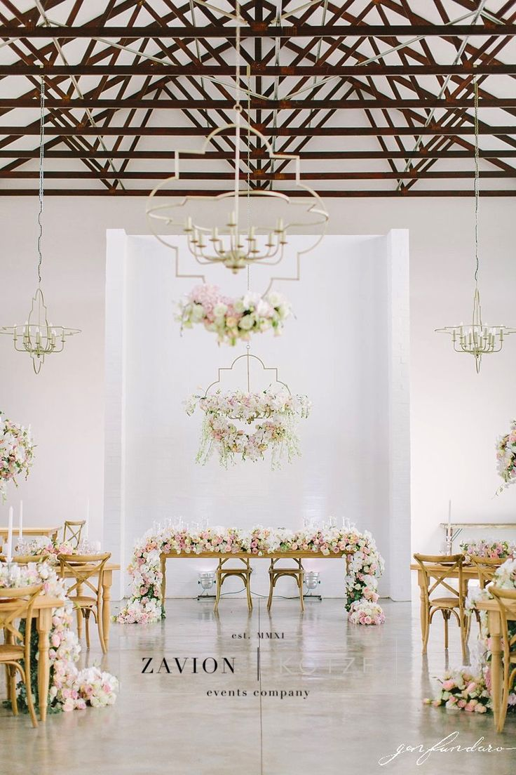 What a wedding reception hall! This wedding was breathtaking and incredible! We loved the floral runners, hanging arrangements, suspended arrangements, raw wooden tables, floral art, decor, gold, white, pink, orchids, white wedding. floral design, royal wedding