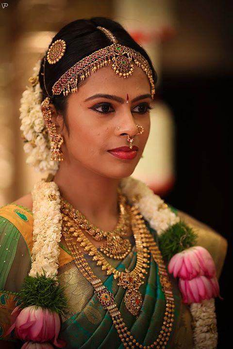 South Indian bride. Temple jewelry. Silk sari.