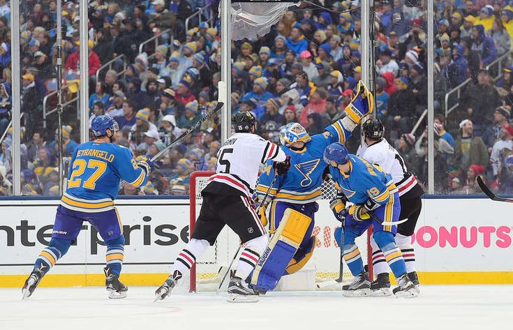 Blues vs. Blackhawks - 01/02/2017 - St Louis Blues - Photo Galleries Jake Allen #34 of the St. Louis Blues grabs the puck with his glove during the 2017 Bridgestone NHL Winter Classic