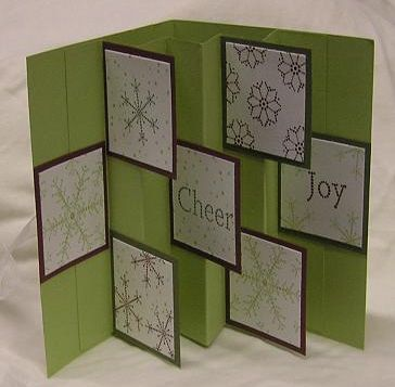 """Flag Card: Base 81/2'' x 5 1/2""""; inside 51/2"""" x 8"""". Then score the inside piece every 1 inch across to have 8 panels. Then fold this paper like an accordion. Glue one end panel at 1 inch from the inside edge of the card. Then glue the other end at 1"""" from the inside edge of the card. Cut 7 pieces of paper (flags) 2"""" x 2"""" and glue in the appropriate places. Read more: http://www.splitcoaststampers.com/gallery/photo/374988#ixzz2azU1xlqM"""