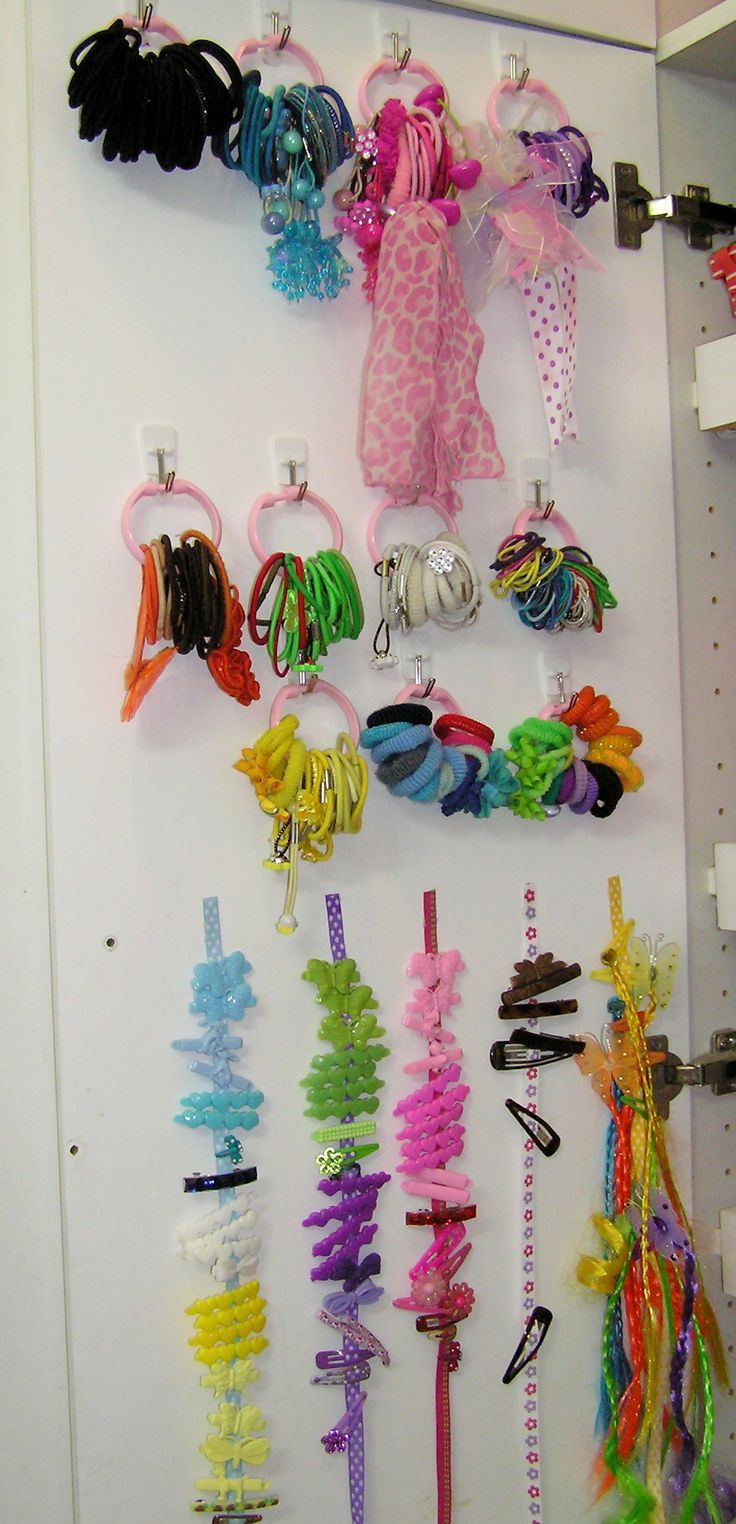 Finally organized the barrettes & hairbands! Items used: 1 pkg of shower curtain rings from Dollar Tree, Command adhesive hooks & Ribbon from Target dollar bins. Total spent $15.  Inspired by: http://shadytreediary.blogspot.com/2011/05/hairbands-unite.html, http://suchprettythings.typepad.com/my_weblog/2011/09/pretty-organized-hair-accessories.html, http://kimboscrafts.blogspot.com/2011/01/headband-holder.html…