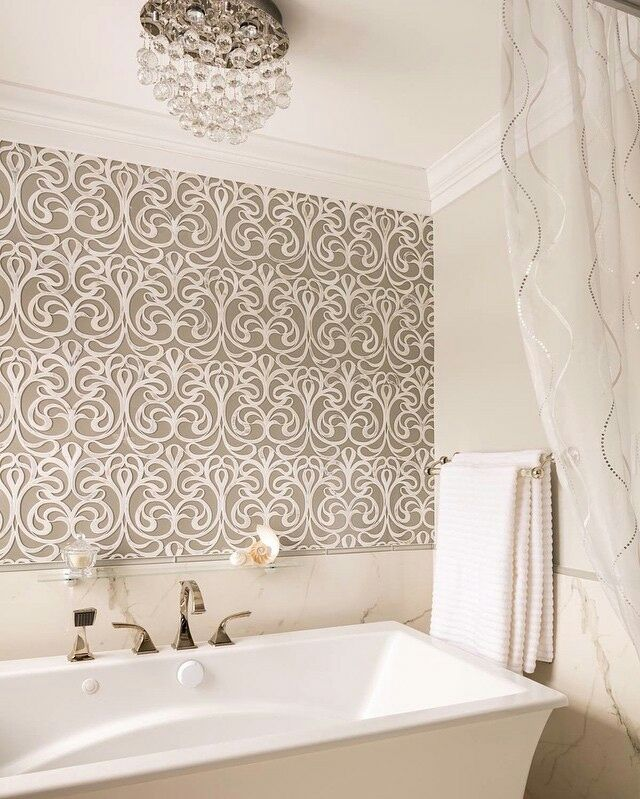 Artistic Tile I Our Danse Lucido waterjet mosaic tile creates an elegant rhythm in this master bathroom by Heather Scott of Bartelt Remodel. Danse is formed by the artisan's hand and eye, then translated in the sophisticated waterjet technique. Stone colors and combinations are customizable.