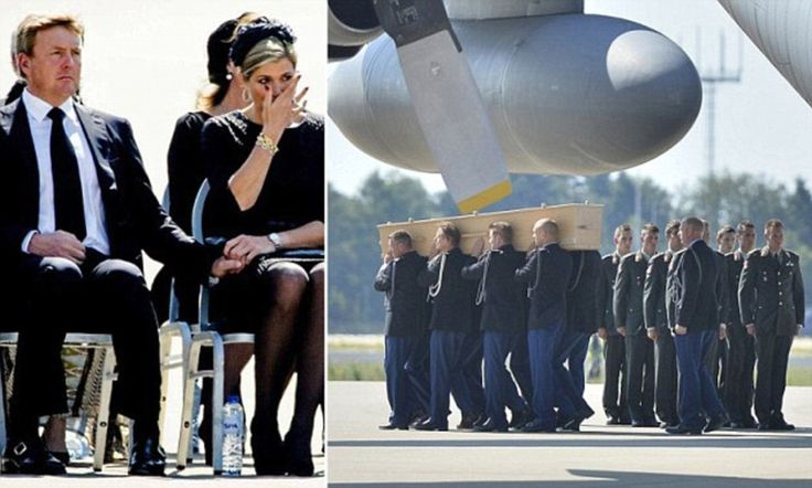 Bodies of #MH17 victims arrive back in the Netherlands