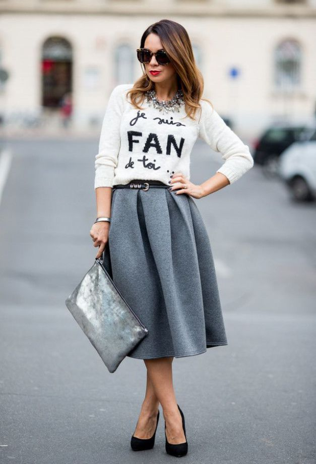 Remember just a few short months ago, when our wardrobes primarily consisted of midi skirts, mules, and crop tops? Those days are long gone, but that doesn't mean you have to put away your favorite skirt style when the temperatures drop. Browse through our gallery to see seven cozy ways to style a m