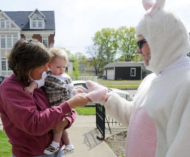 Meg Michalowski, left, holds her one-year-old grandson Landon as he interacts with Joe Martinson dressed as a bunny for Easter on Sunday, April 8, 2012, in Winona. (Alexa Wallick/Winona Daily News)