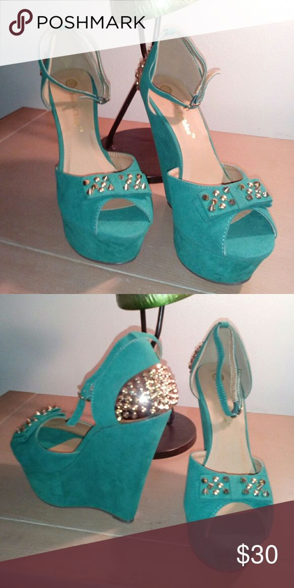 Seafoam green wedges A slick green wedge detailed in spikes and a decorative ankle wrap strap. Chase&Chloe Shoes Wedges