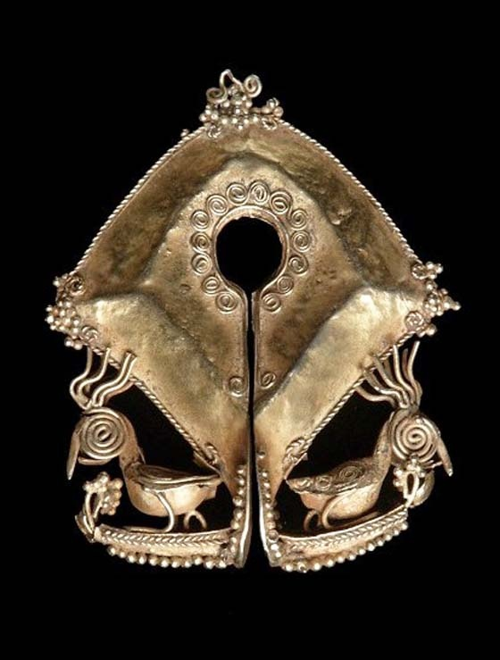 Indonesia ~ Small Sunda Island region   A Mumuli ear ornament or pendant worn from the Sumba Island, Nusa Tenggara Timur province   ca. late 19th to 20th century   gold   These types of ornaments were often included in the gifts given to the bride by the groom's family and were only worn at special occasions.  Mumuli's are usually diamond in shape, are usually ornately decorated, this one shows a bird standing in a boat.