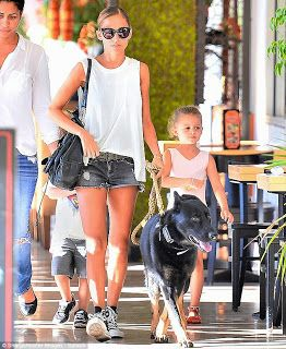 Nicole Richie her two kids a dog and a nanny.