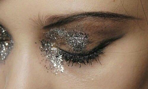Sleek brows & heavy silver glitter, editorial eye makeup