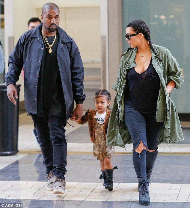 Oh mommy! Kim Kardashian wore a low-cut black top that showed off her chest when she took ...