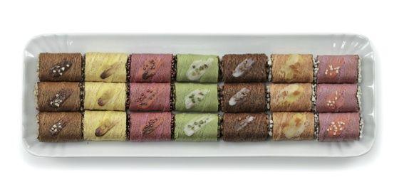Evoluzione contemporanea del classico cannolo Bussy, i mini cannoli Lepetittè sono perfetti per la preparazione di freschi e originali finger food. Croccanti cialde arrotolate e semi-schiacciate, ricoperte internamente di cacao, aromatizzate e colorate con ingredienti naturali. Da riempire con creme, ganache o gelato soft, sono disponibili in sette varianti diverse, per soddisfare ogni gusto.