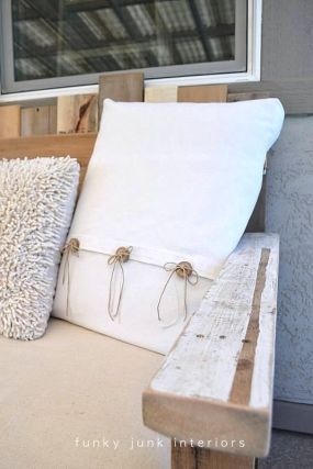 A fusion of warm whites were used to dress the build up. The mattress cover was wrapped with a painters drop for quick and easy cleaning. An eclectic mesh of pillows allow for quick positioning for different sits.