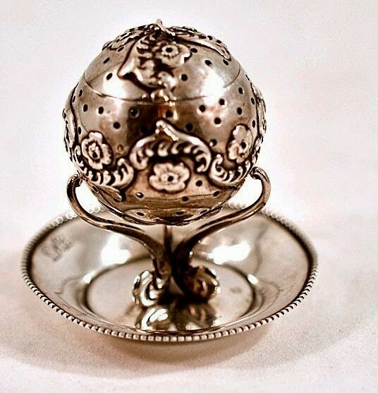 Antique tea ball infuser with stand. Too cool
