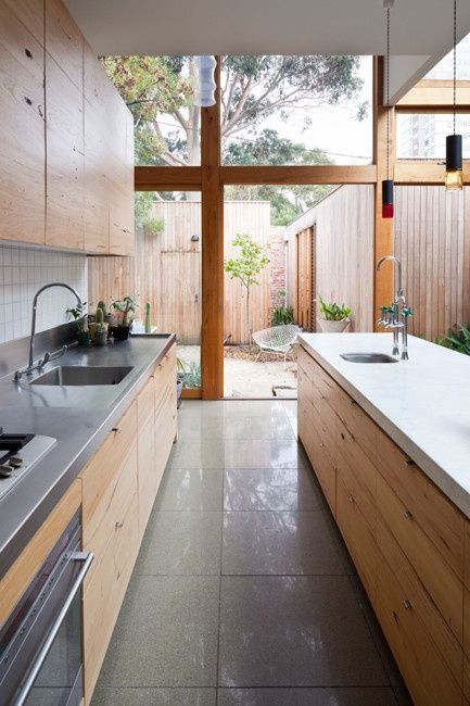 I love everything about this- 2 sinks, different surfaces, large window/ door, galley style.........