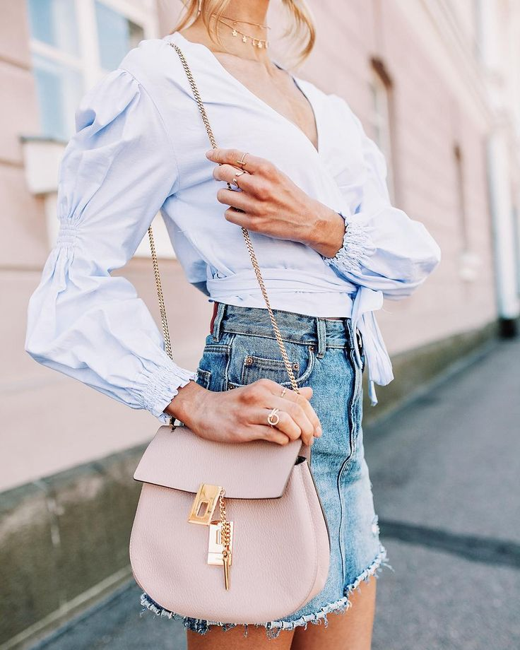 Pastels for summer: outfit details with cool statement sleeves, baby blue wrap top & denim skirt.