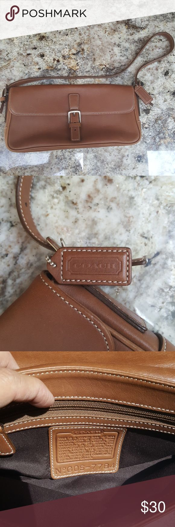 Purse Gently used camel clutch with strap like new all leather. Coach Bags Mini Bags