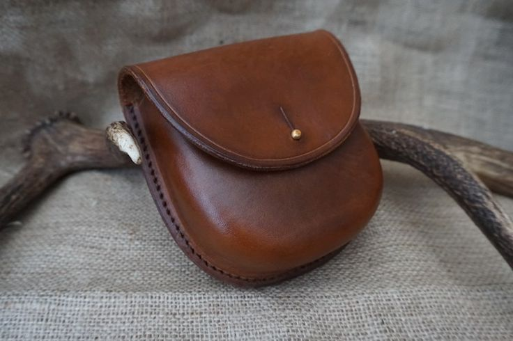 The finished hand stitched leather Woodland  pouch. looks so simple in design and yet takes so many stages to make it look as good as it does..