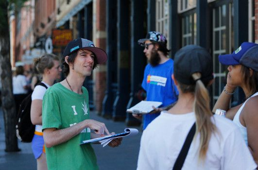 In this June 11, 2016 photo, Robert Cleary, left, a marijuana reform advocate with the group NORML, talks with passersby, gathering signatures on a petition to get a pot club initiative on the ballot. The Denver Elections Commission rejected the petition, meaning the initiative will not be on the ballot in November.