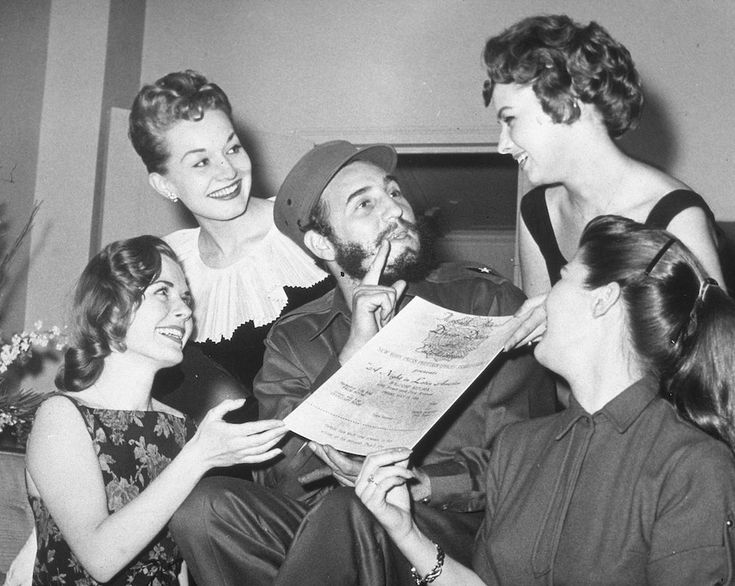 Castro is presented with an invitation to the New York Press Photographer's Ball. 1959: The year Fidel Castro completely charmed America