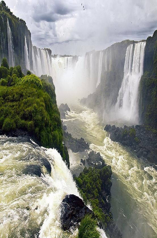 Iguazu Falls, Argentina-Brasil, I went to the Argentina side and it was one of the most stunning waterfalls I have ever seen. Now I just need to see Victoria falls in Zambia.