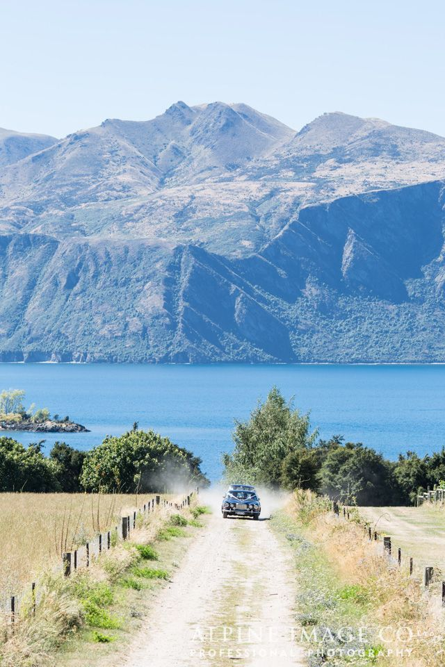 Driving to the vineyard wedding ceremony spot in style- at Rippon, Lake Wanaka