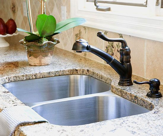 "Undermount Sinks, undivided of course with one of those ""hook"" faucets"