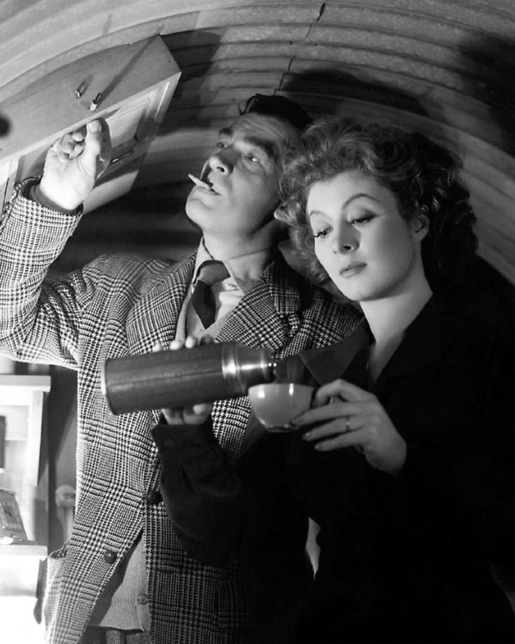 Mrs Miniver 1942.  Walter Pidgeon & Greer Garson - One of my favorites! Inside their Anderson shelter in their back garden.Great Movie. A must see...