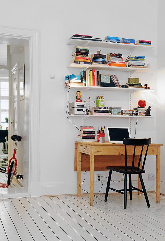 little work space shelving above desk