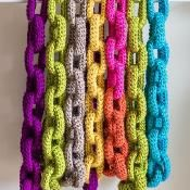 Crochet Chain Link Scarf. Cute idea, though I'd probably use a muted color. Could be done with sewing, too.