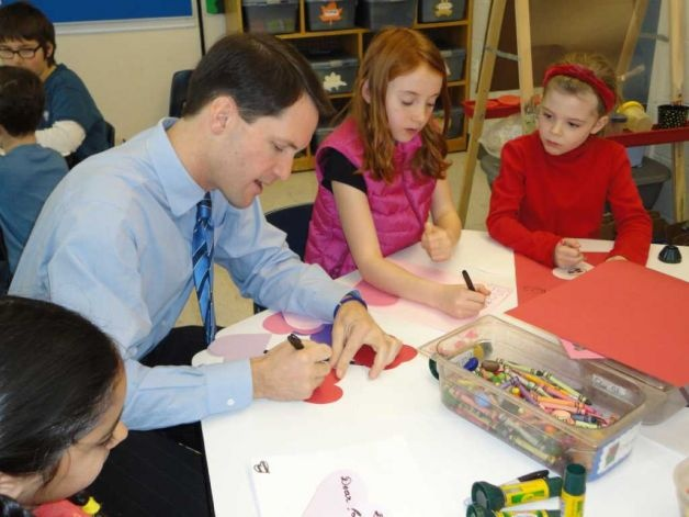 U.S. Rep. Jim Himes worked with Madison Foge, center, a fourth-grader, and kindergartner Lane Nelson, 6, at Kings Highway Elementary School on Monday to make Valentines cards for military veterans, which Himes was to distribute to veterans on Valentine's Day.