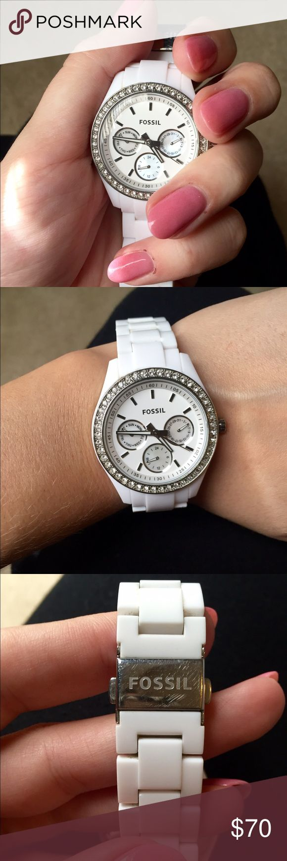 Fossil watch Beautiful white watch with silver detailing. In like new condition, only worn a handful of times. Needs new watch battery, minor scratches on clasp. I have a small wrist and it fits lose, links are remove able for adjusting. Fossil Accessories Watches