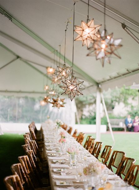 Rustic, whimsical lighting makes this tablescape special Photo: KT Merry