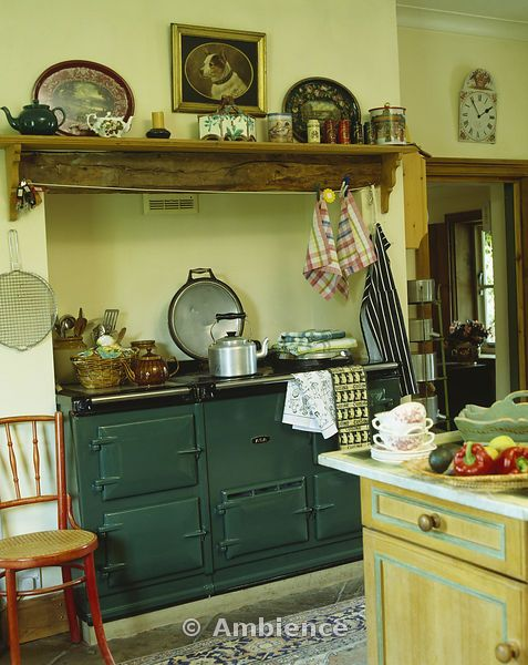 Ambience Images | Wooden shelf above green Aga in traditional country kitchen