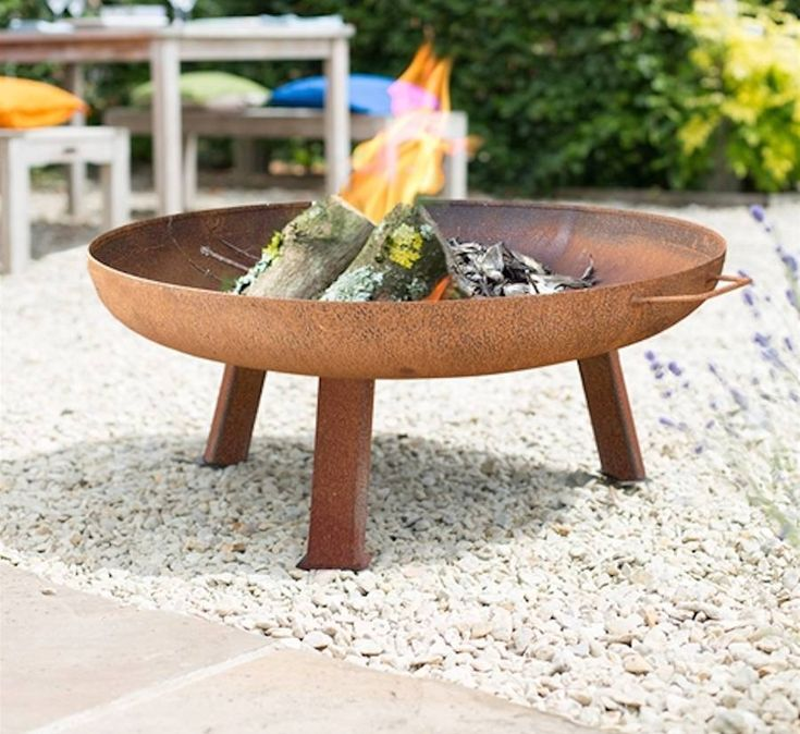 Large Industrial Style Steel Firepit. This steel firepit is simple yet elegant and an easy and efficient way to add warmth and ambience to your outdoor space