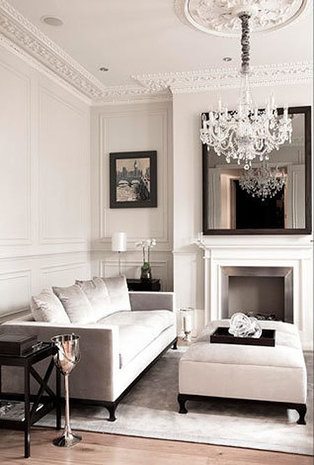 White/neutral living room with crown molding