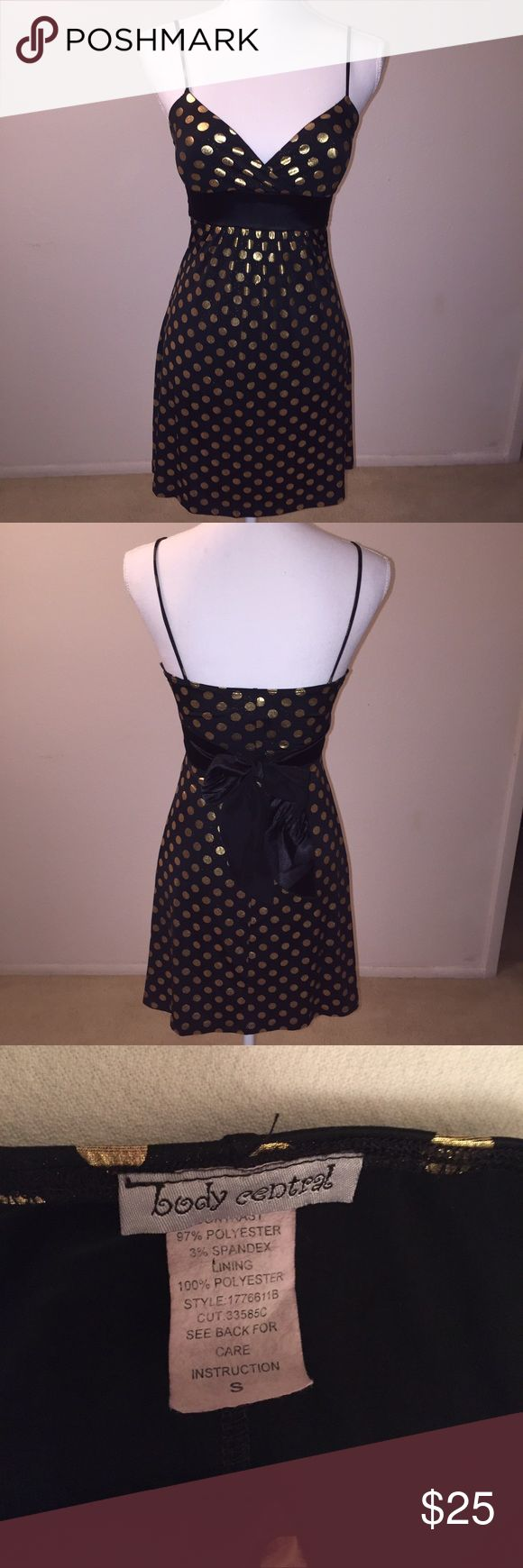 Body Central Black Gold Metallic Polka Dots Dress This adorable dress from Body Central features shiny gold polka dots and a big ribbon tie in the back. SO cute! It is size small and is in excellent condition. If you have any questions, just ask! Body Central Dresses