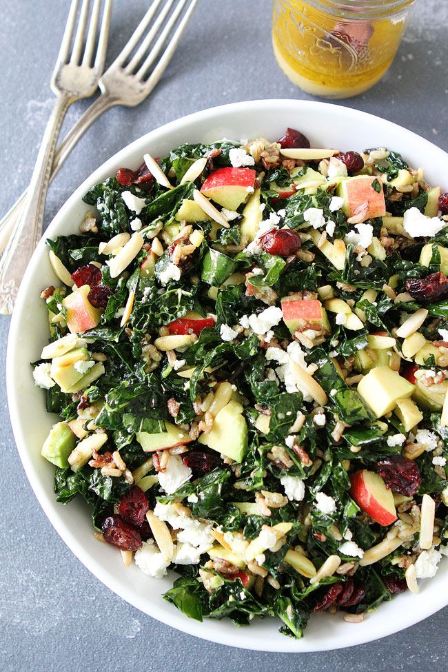 Kale and Wild Rice Salad Recipe on twopeasandtheirpod.com Kale salad with wild rice, apples, avocado, dried cranberries, goat cheese, and almonds. This hearty salad is my absolute favorite!