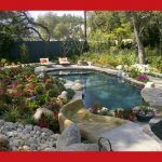 Inspiration For A Large Timeless Backyard Custom Shaped Pool Remodel In Other With Natural Stone Pavers And A Water Slide More Modest Version Of A Curvilinear Pool