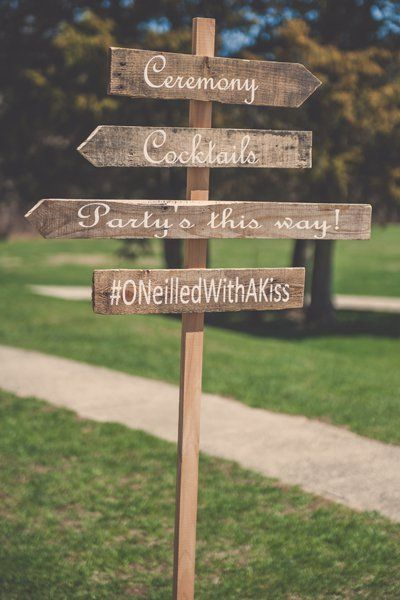 Lead the way and encourage photo-sharing with a rustic sign, handmade from reclaimed wood.