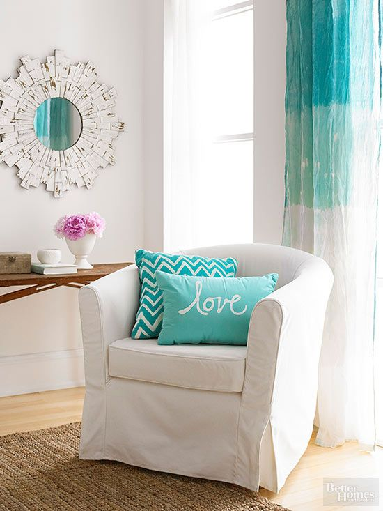 Create an ombre effect by dipping a teal cotton curtain into equal parts bleach and water.