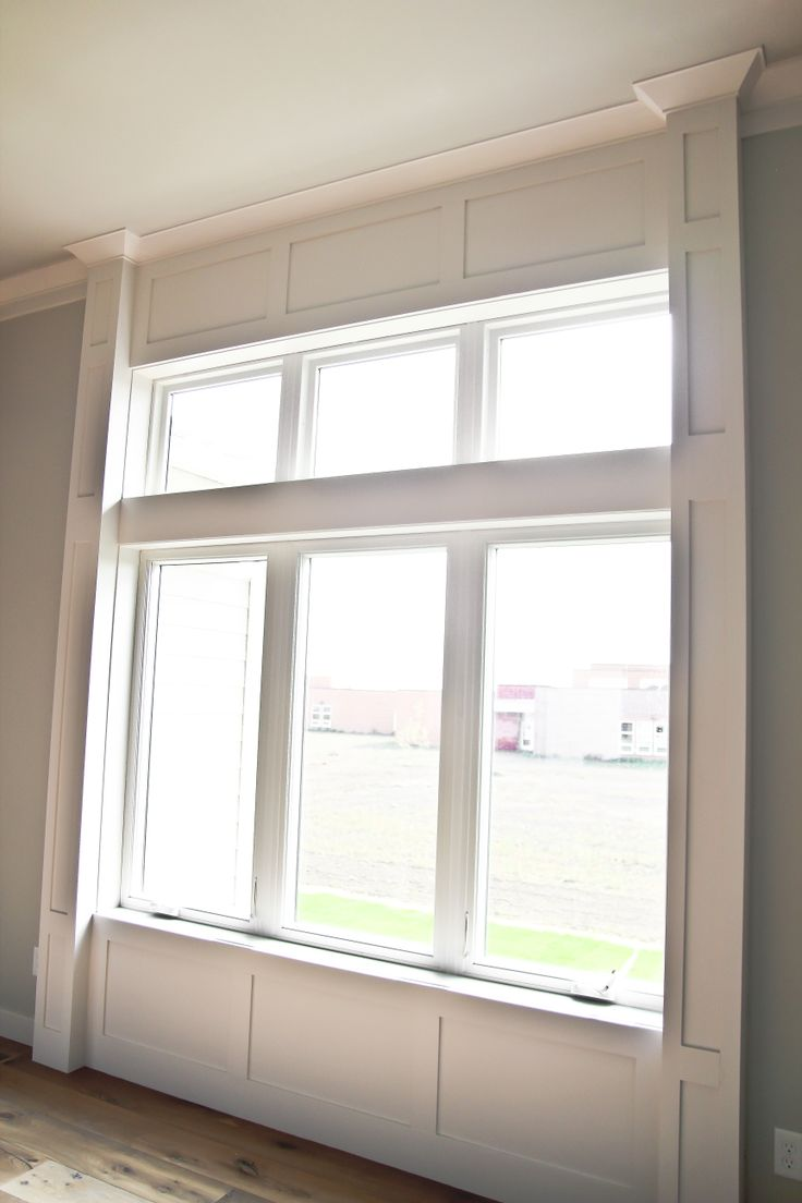 Simple interior window trim - Framed In Simple Lines With Millwork Details Adds Design Interest To This Room