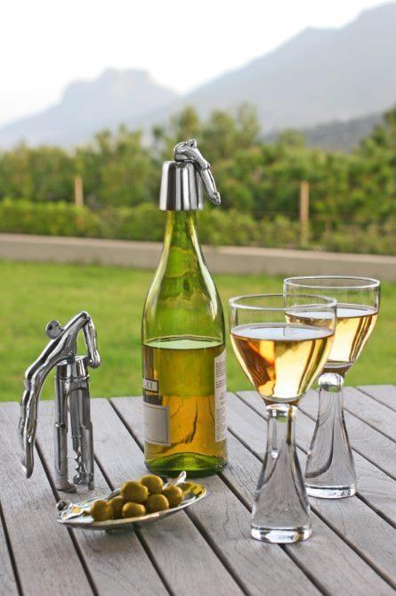 CARROL BOYES - NEW WINE GLASSES, CORKSCREW, BOTTLE STOPPER AND OLIVE DISH.