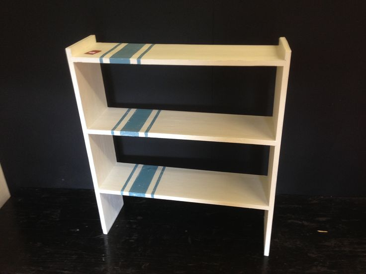 Solid wood bookshelf painted in a grain sack design with Rust-oleum Antique White and Belgrave Chalky Furniture Paint with a delicate distress. £45