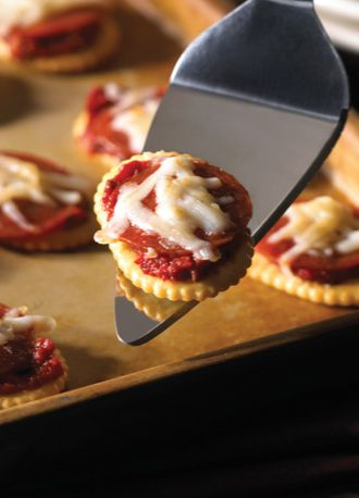 Transform crackers into mini pizzas in less than 20 minutes—perfect for fall football parties!
